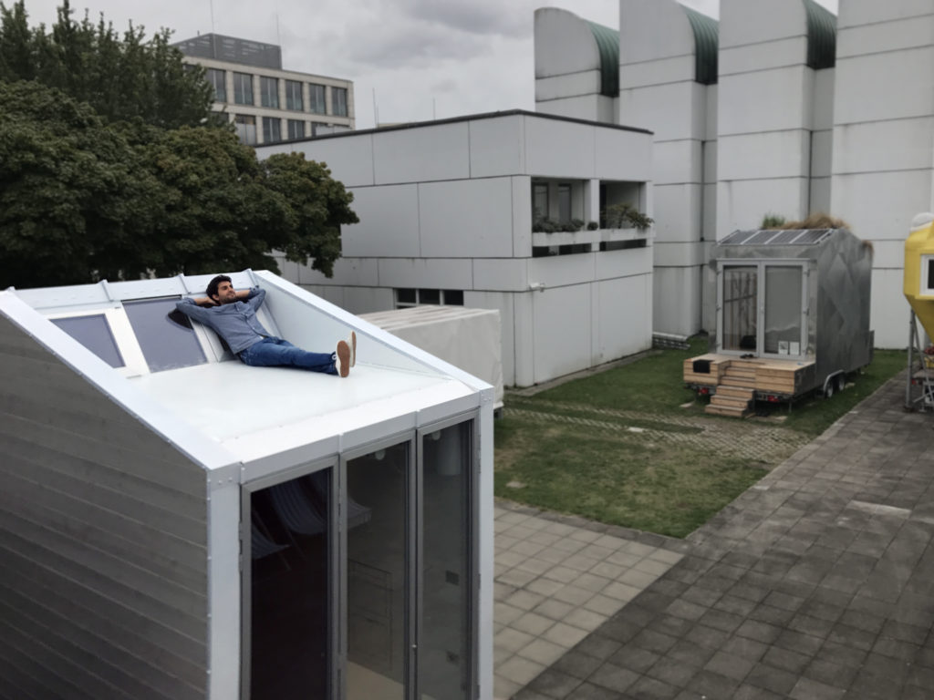 Leonardo Di Chiara relaxing on his own designed aVOID tiny house rooftop at Bauhaus Campus Berlin.